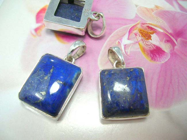 Quality fashion accessory wholesale importer, Royal blue precious gemstone pendant with 925. sterling silver frame