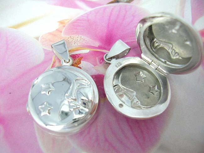 Fashion jewelry retail wholesaler, Celestial design etched into 925. sterling silver circular locket pendant