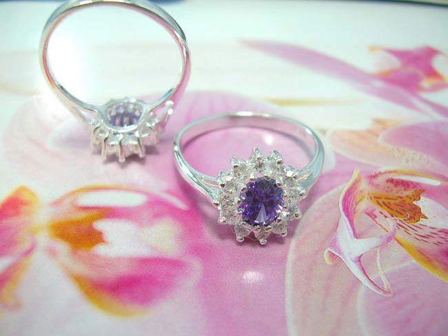 Contemporary bali wear accessory shop, Amethyst gemstone in center of imitation diamonds forming petals to beautiful flower inspired ring