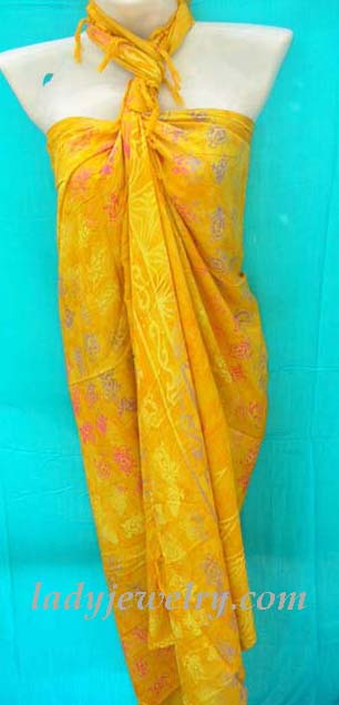 High style leisure apparel store. Rayon bali sarong wrap in yellow with multi colored turtle motif design