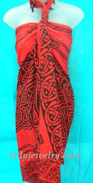 Intricate Celtic knot art pattern on exotic red and black pareo wrap. Ladies urban beach beauty supplies