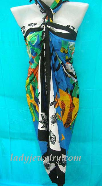 Enchanted sea world theme on blue, white and green caribbean sarong cover up. Ladies gift apparel import shop.