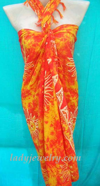 Bali bali apparel jewelry collection. Orange and red tie dye fashion sarong with white summer sun pattern