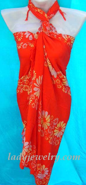Stylish red balinese fashion wrap skirt with daisy flower pattern. Womens jewelry accessory summer shopping