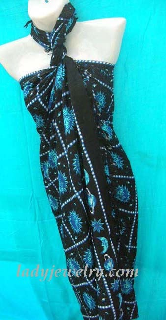 High style clothing supplies. Solar and lunar print art on blue and black exotic party sarong